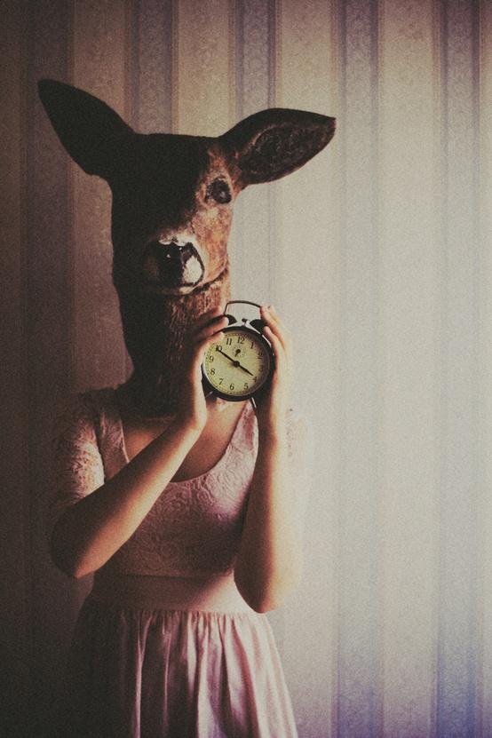 Deer with vintage alarm clock