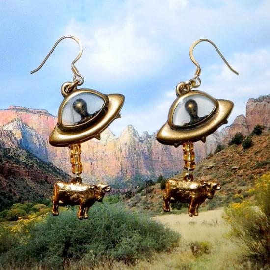 Aliens abducting cows earrings.