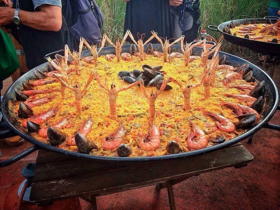 Fiesta in paella. Happy food in Spain.