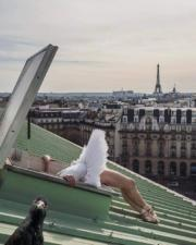 Pigeon selfie with ballerina on a roof in Paris