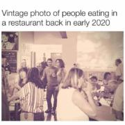Vintage photo of people eating in a restaurant back in early 2020